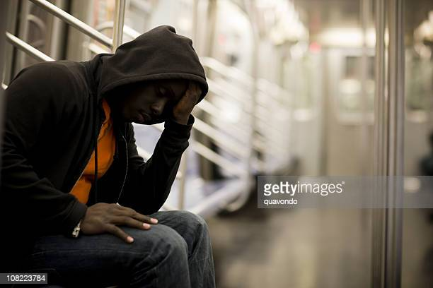 Black Man with Head in Hands on Subway, Copy Space