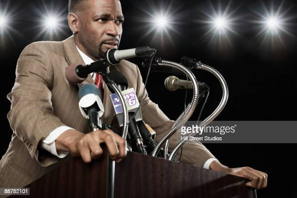 African American man at press conference podium