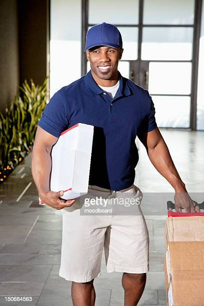 African American man carrying boxes for delivery