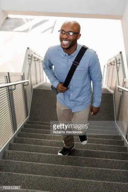 African American man climbing staircase