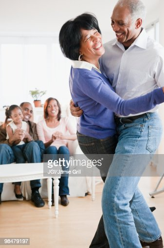 African American Living Room Apartment Decor: African American Man Dancing With Wife In Living Room