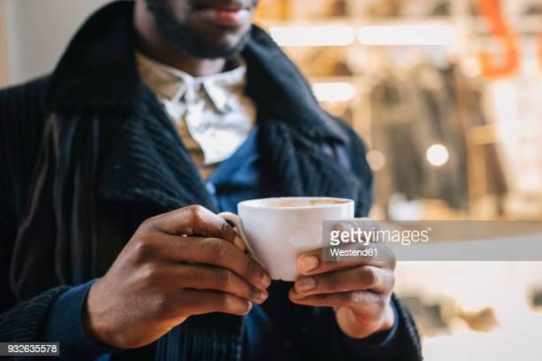 African american man drinking coffee