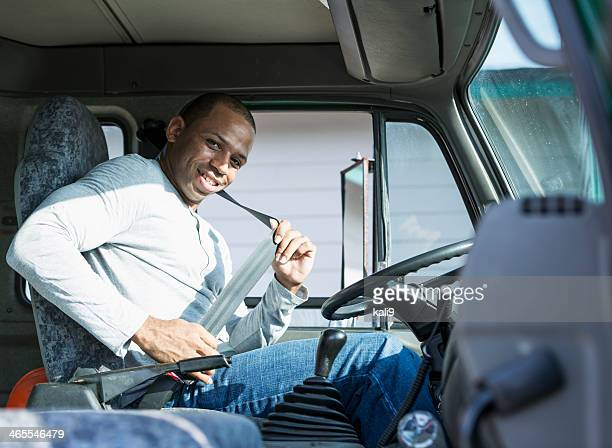 African American man driving truck