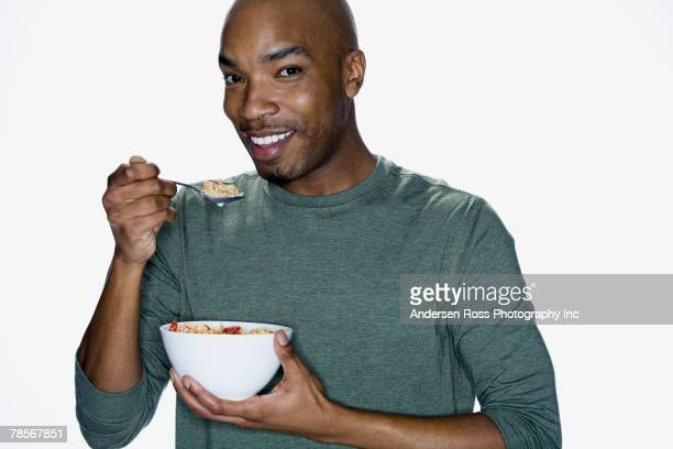 African American man eating cereal