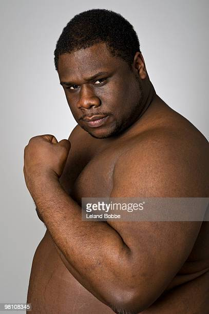 african american man flexing his bicep muscle