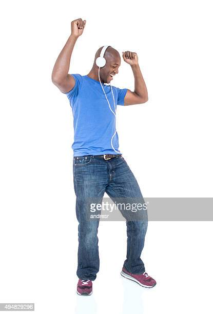 african american man having fun listening to music - dancing silhouette stock pictures, royalty-free photos & images