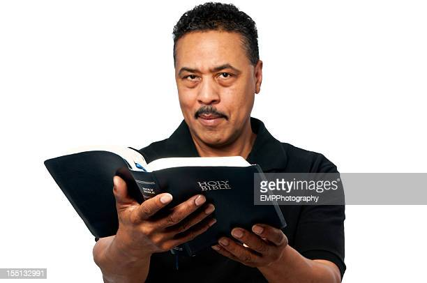 African American Man Holding a Bible Isolated on White
