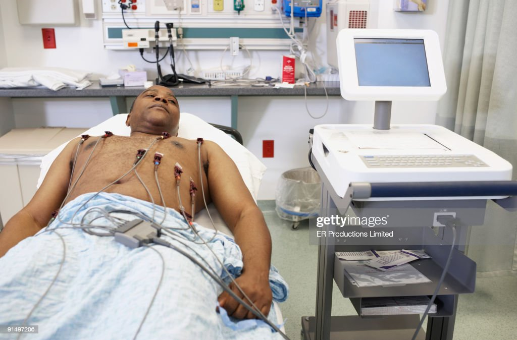 African American man in hospital bed : Stock Photo
