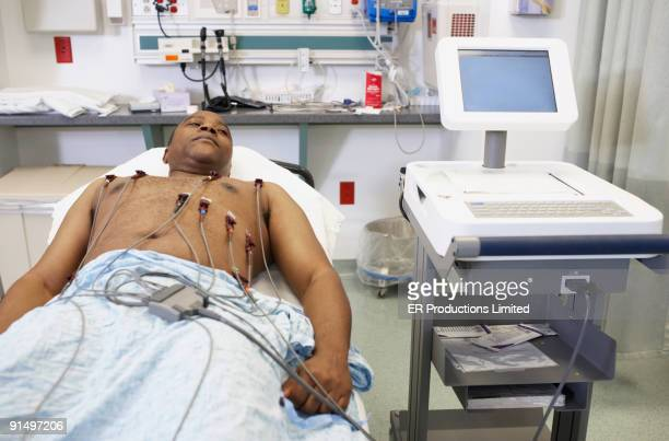 african american man in hospital bed - pulse trace stock pictures, royalty-free photos & images