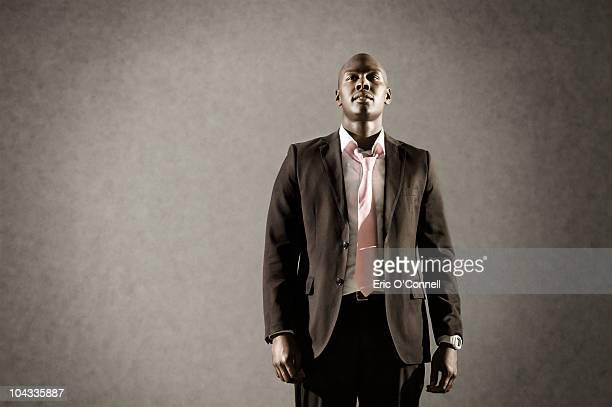 African American man in suit looking satisfied