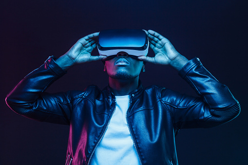 African american man in vr glasses, watching 360 degree video with virtual reality headset isolated on black background 1153003853