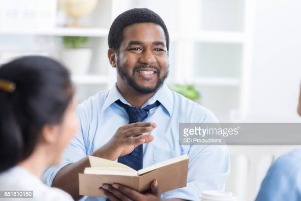 African American man listens during Bible study discussion