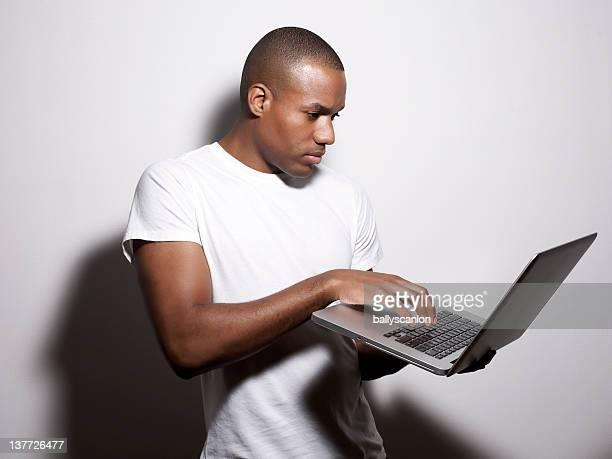 African American Man Looking At Laptop.