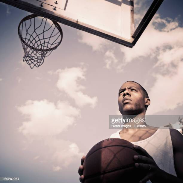 African American man playing basketball on court