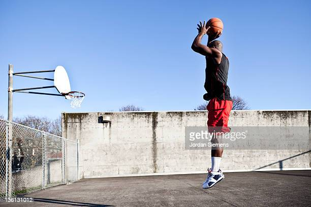 African American man playing basketball.