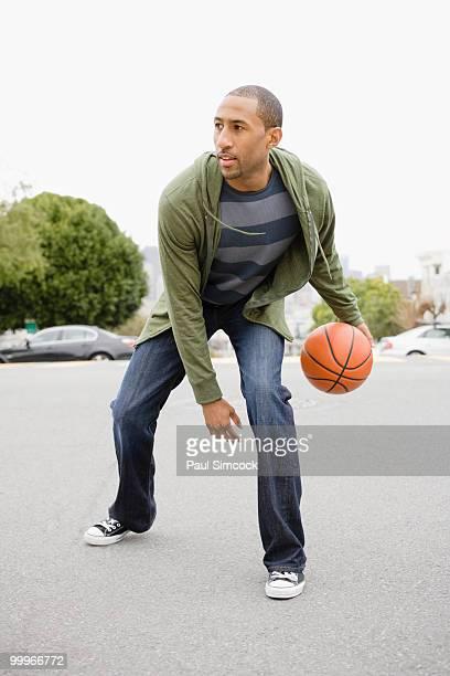 african american man playing basketball - ドリブル ストックフォトと画像