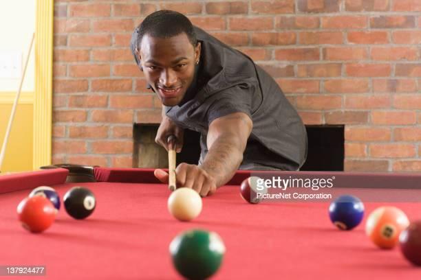 African American man playing pool