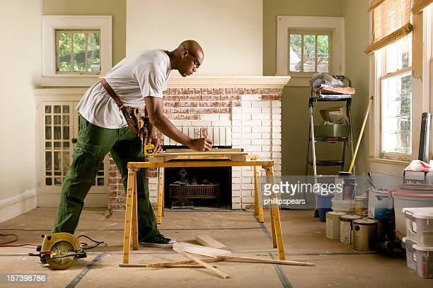 African American man renovating home interior.