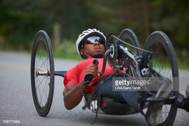 African American man riding handcycle