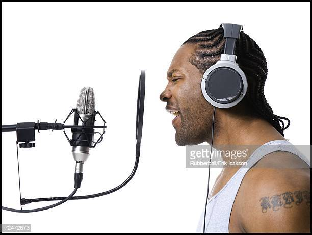 African American man singing into microphone