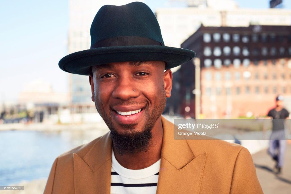 African American man smiling at waterfront : Stock Photo