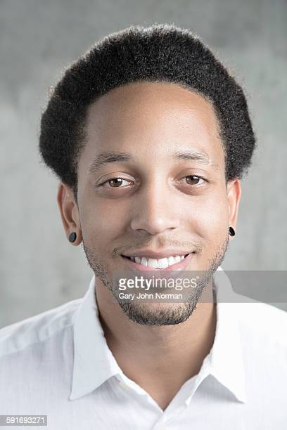 African American man smiling, head shot.