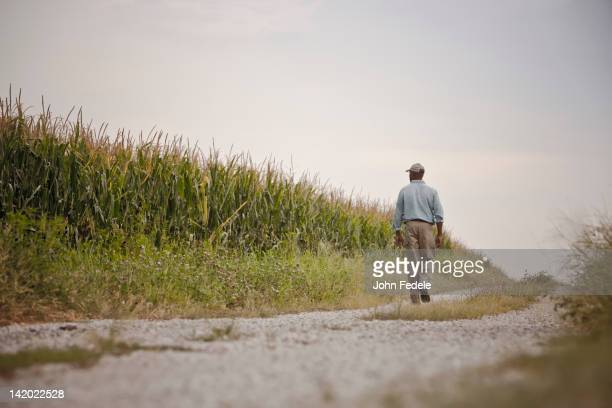 African American man walking on remote path