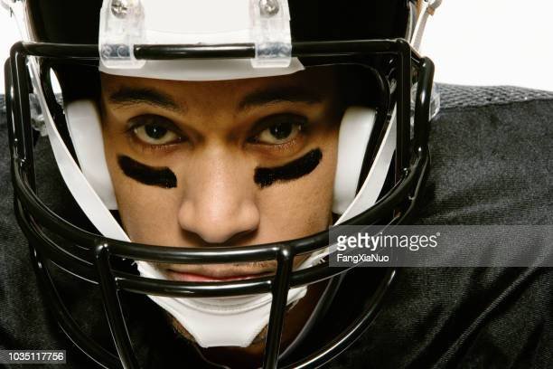 african american man wearing football uniform - safety american football player stock pictures, royalty-free photos & images