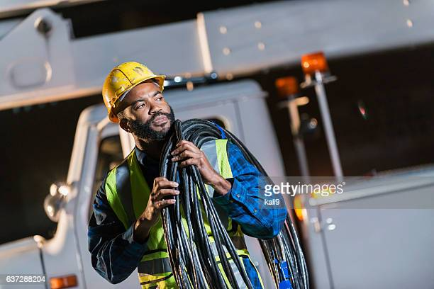 african american man with cherry picker truck - cable stock pictures, royalty-free photos & images