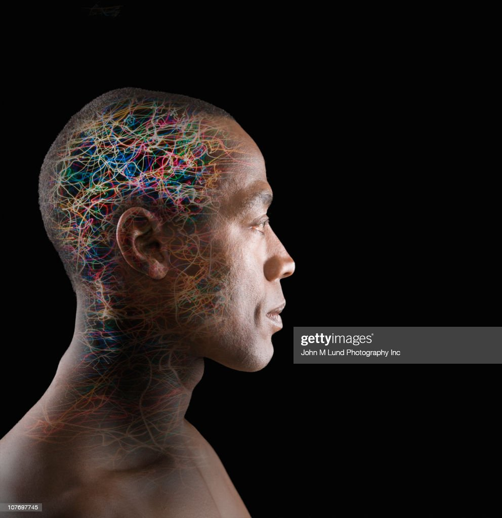 African American man with colorful wires in head : Stock Photo