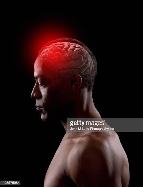 african american man with glowing brain - hemorragia fotografías e imágenes de stock