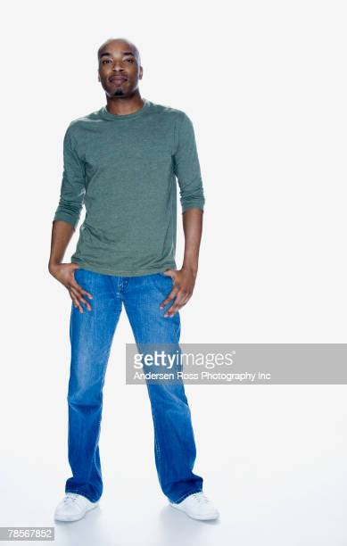 African American man with thumbs in pockets