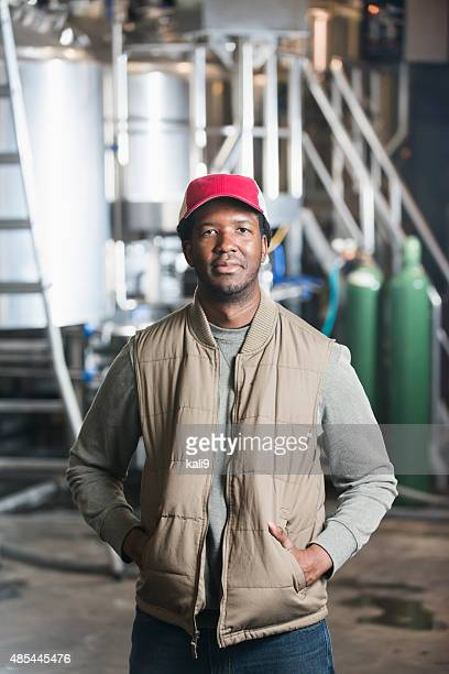 African American man working in microbrewery