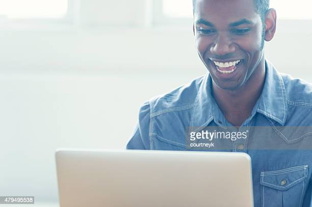 African American man working on a laptop computer