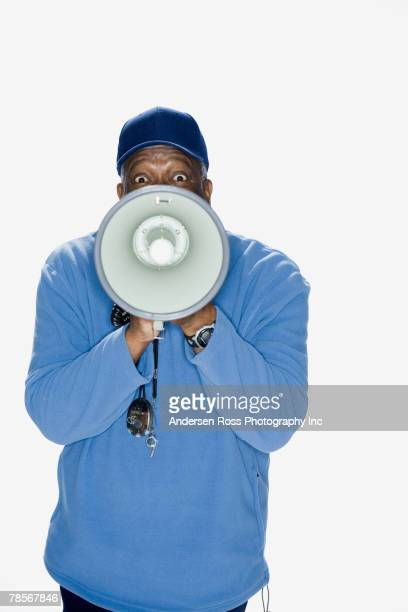African American man yelling into megaphone