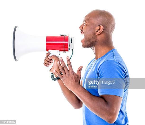 African American man yelling through a loudspeaker