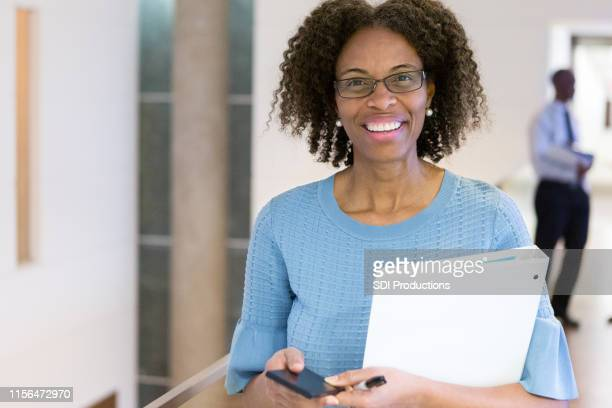 african american manager surfs the net - school principal stock pictures, royalty-free photos & images