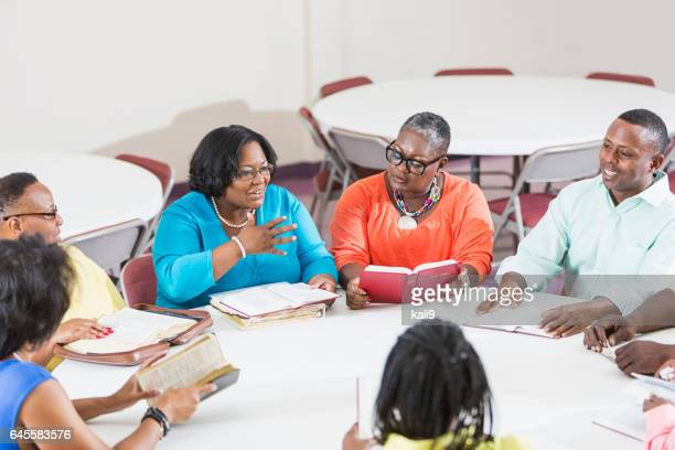 african american men and women at bible study meeting - church stock pictures, royalty-free photos & images
