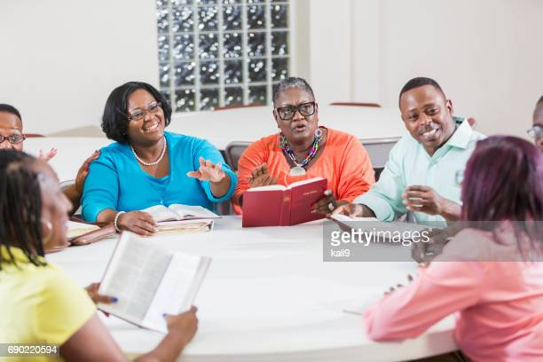 african american men and women at bible study meeting - minority groups stock pictures, royalty-free photos & images