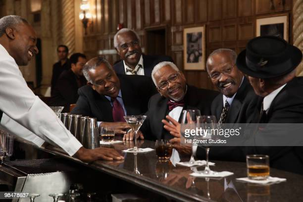 African American men drinking at bar