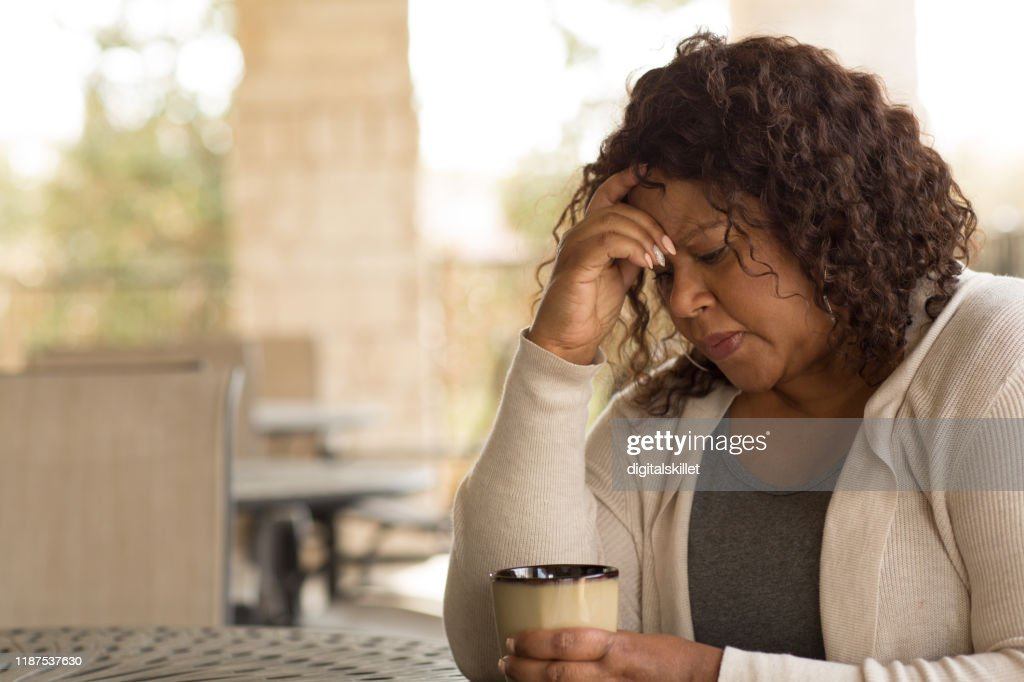 African American middle age woman looking sad. : Stock Photo