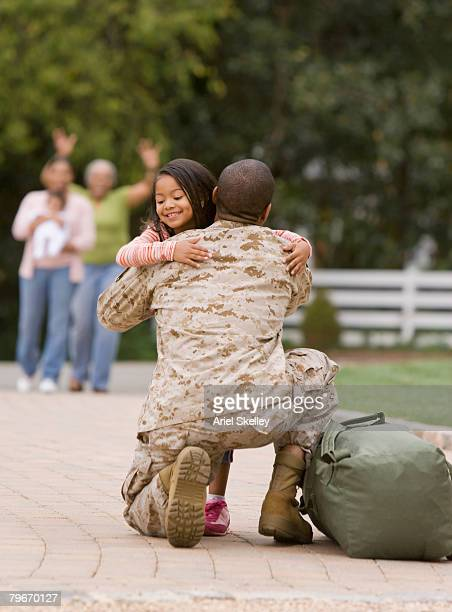african american military father hugging daughter - genderblend stock-fotos und bilder