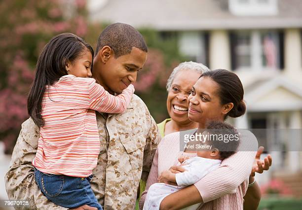 african american military father hugging family - marines military stock photos and pictures