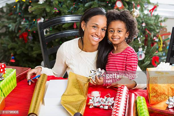 African American mother and child wrapping Christmas presents