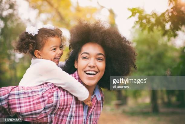 african american mother and her daughter. - mother's day stock pictures, royalty-free photos & images