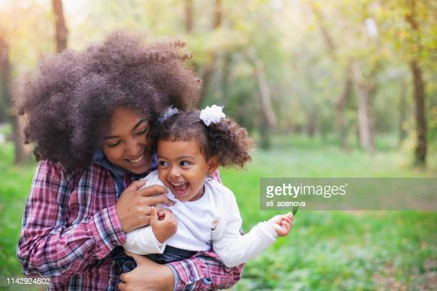 african american mother and her daughter. - black mothers day stock pictures, royalty-free photos & images