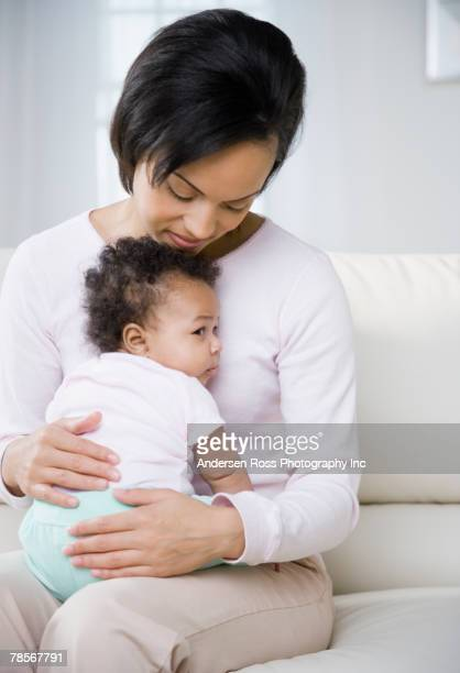 African American mother hugging baby