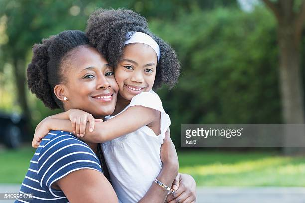 African American mother with mixed race little girl