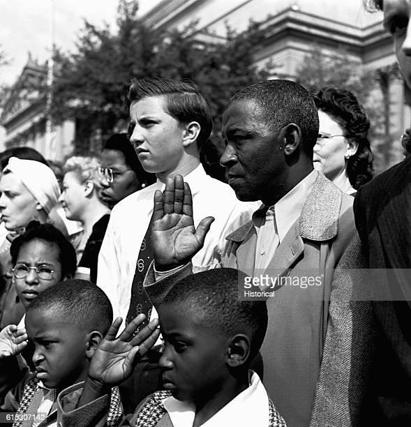 African American mourners salute President Franklin D Roosevelt's funeral cortege in Washington DC April 14 1945