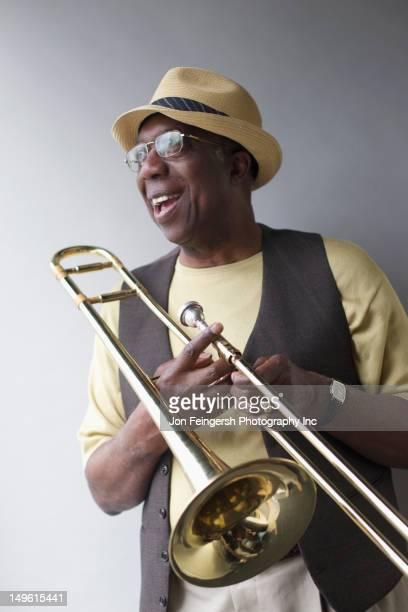 African American musician holding trombone